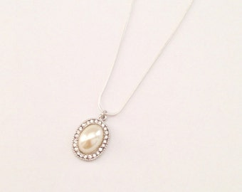White pearl and rhinestone charm necklace