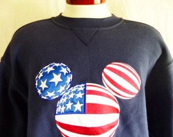 vintage 90's Walt Disney Disneyland Anaheim Mickey Mouse American flag silhouette applique logo navy blue fleece graphic sweatshirt Large