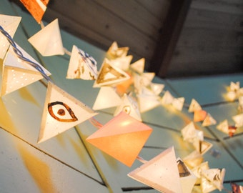 Paper Pyramid Light Garland - EVIL EYE - handmade paper lanterns with hand-painted eyes, pinhole cutouts, speckled paper, and cocoa ink
