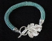 Ice Blue Viking Knit Hand Woven Wire Bracelet Leaf Clasp