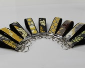 Yellow and grey key fobs