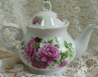 Gorgeous China Teapot loaded with Magnificent Roses.  Perfect for Afternoon Tea.