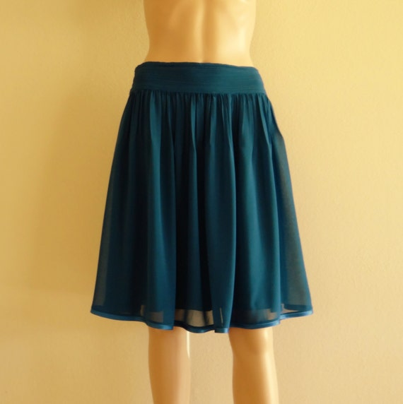 Available in Teal Blue, Rose Gold, and Navy Maxi Satin Skirt Tie Waist Detail Wrap Style % Polyester.