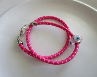 Pink and white double wrapped bungee cord bracelet with silver toned clasp and european style bead, teen gift, pink bracelet, evil eye bead