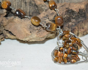 Tiger eye nugget bracelet with a heart shaped tree of life focal.