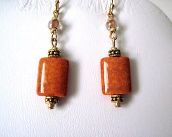 Gold and cinnmon  earrings