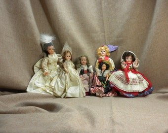 collection of 6 female souvenir dolls