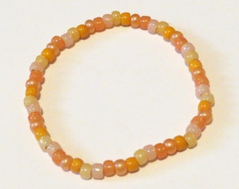 Orange Rainbow Bracelet made from Seed Beads and stretch cord. Sherbert, peach beads.