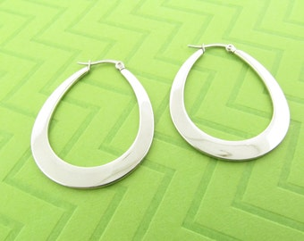 large stainless steel hoop earrings. 1 3/4 inches long
