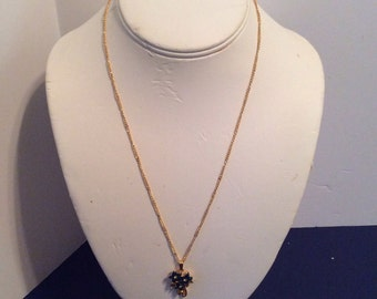 Gold toned chain and pendant 19 in