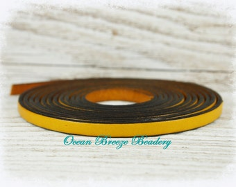 Flat Leather . 5 x 1.5mm . 3 feet . Mustard Yellow with Black edge