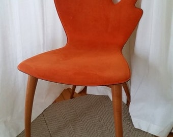 Sculptural chair. Orange. Like new