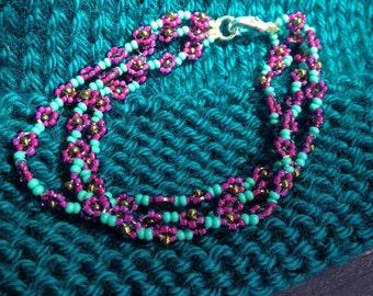 Triple stranded daisy chain bracelet- plum and aqua