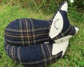 A snoozy fox doorstop in tartan wool.  Fox bookend.