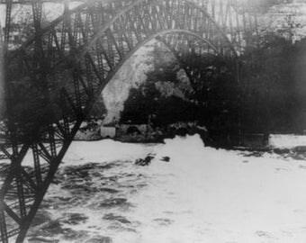 Biplane Flies Under Niagara River Bridge Photograph (Art Prints available in multiple sizes)