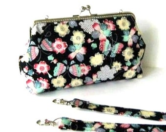 Frame purse colorful flowers and butterflies on black clutch frame bag made of cotton fabric, silver metal bag frame and removable strap