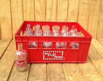 "Vintage ""The Pop Shoppe"" Soda Case and Bottles"