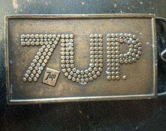 7UP styled brass belt buckle