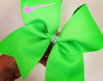Bright lime green and hot pink glitter swoosh cheer bow
