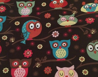 Owls on brown cotton fabric