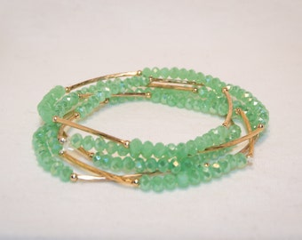 Light Green Elastic Beaded Bracelet with a Hint of Gold