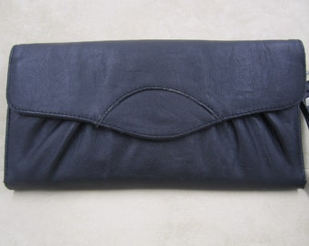 A slim black soft faux leather foldable clutch wallet