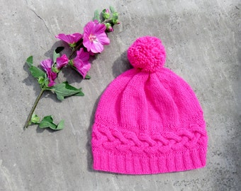 Girl's hand knit beanie with pom pom in bright pink