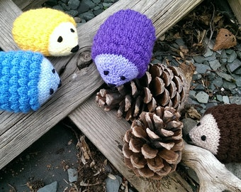 Knitted Hedgehogs in all the colours of the rainbow