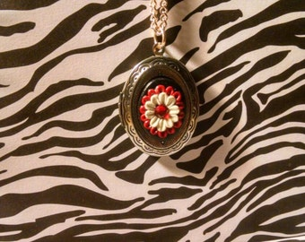 Red black and white flower locket