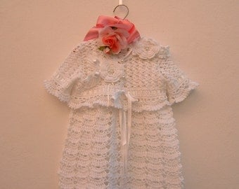 Christening dress, sweater and crochet head band performed in white cotton. Crochet lace baby fashion. Made to order