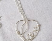 """Sterling Silver Heart Pendant with the word """"Love"""" written in wire inside the heart for """"The Make For Good"""" Charity"""