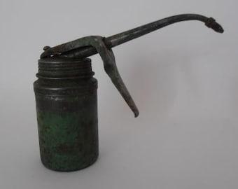 A little Wesco, English, green vintage industrial oil can! Great garage/automobile memorabilia/man cave decor.