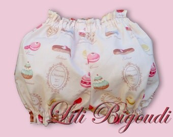 Bloomers baby background pink powder printed macaroons pink pale Bloomer hides another cake layer anthracite dark chocolate