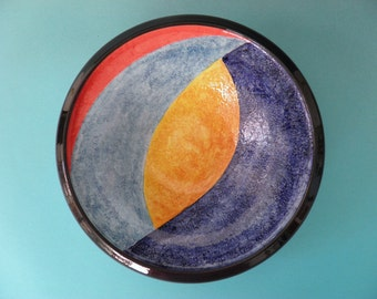 Ceramic bowl molded on a lathe and decorated by hand.