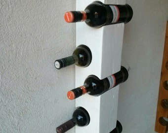 White Wall wine rack for five bottles.. Package includes screws for wall mounting.