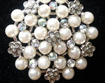 Silver and white flower brooch
