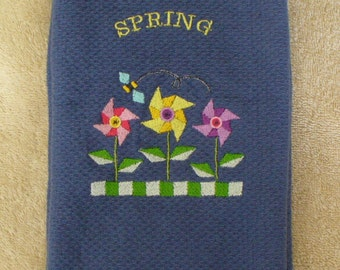 """Blue cotton flat-woven kitchen towel with """"Think Spring"""" and Pinwheels"""