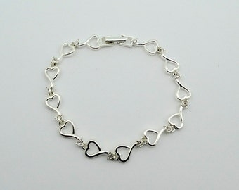 Show Your Love With This Vintage Sterling Silver Heart Shaped Link Bracelet With Rhinestones  #RZHRT-LB1