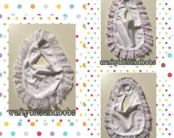 Lace edged Velcro fastening bib