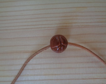 Tiny Brown Peace Bead