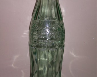 Vintage 12 fl oz embossed Coke bottle