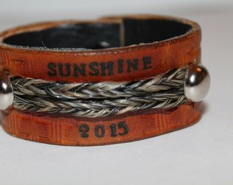 Memorial leather with horsehair cuff