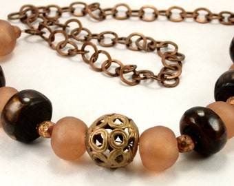 African peach glass, bone, and copper necklace