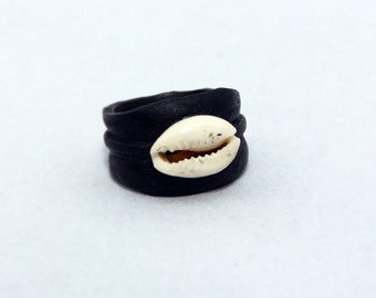 Designer ring made of wood with a shell