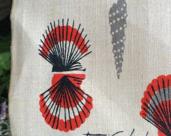 Reduced. Four Tammis Keefe placemats, oatmeal colored linen with orange and black seashells, great mid century design