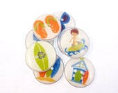 """8 Surfing or Beach Buttons.  Surfer, surf board, flip flops, sun glasses and more  3/4"""" or 20 mm."""