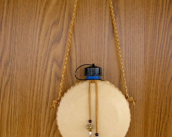 "Cream Canteen, 32 ounce,  wrapped in deerskin leather, with honey lacing, 36"" lariat strap, hand stitched with trade beads"