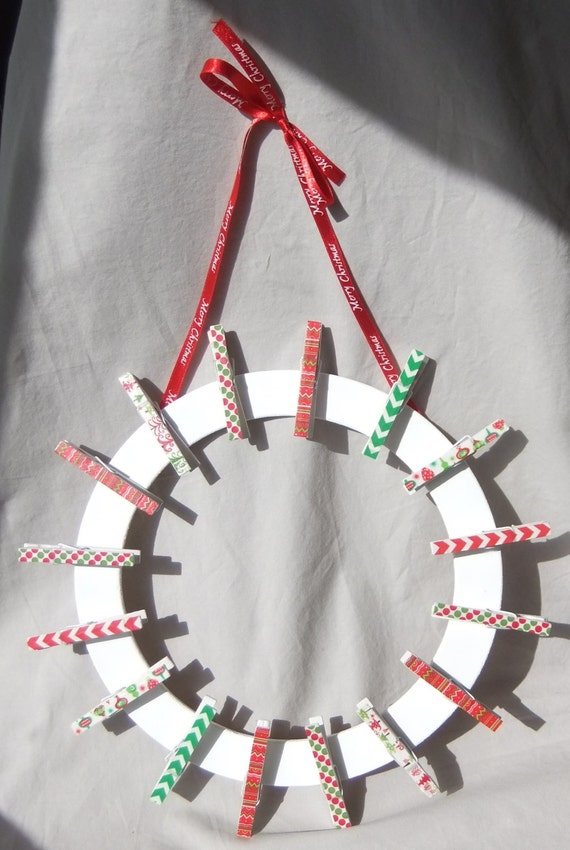 Christmas card wreath clothes pin wreath by katiemadeorigami for Christmas card holder wall hanging