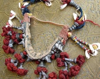 Indian Banjara  shell and vegetable dye pom pom arm band