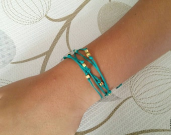 Teal Blue Tie it Wrap Cord Bracelet. Beaded Station Bracelet with gold brass beads. Stackable custom wrap ankle bracelet. Gift for teens
